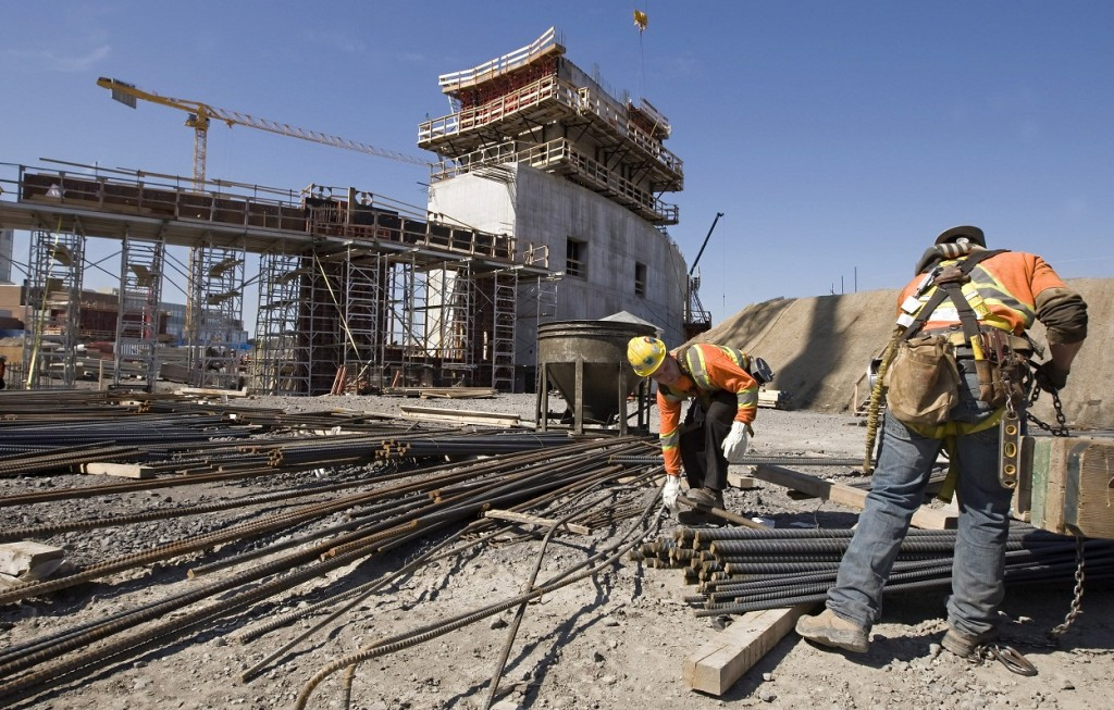 Two men work on the construction site for the new arena in Quebec City, Wednesday, May 1, 2013. THE CANADIAN PRESS/Clement Allard